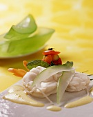 Monk fish with yoghurt sauce and slices of citron