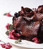 Chocolate gateau with cranberries and candied flowers