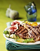 Grilled pork cutlets with figs and grilled vegetables