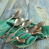 Assorted Silver Spoons on Felt Cloth