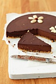 Chocolate mousse cake being cut