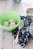 Three Eggs in a Green Bowl; Spoon, Sugar and Cream