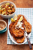 Schnitzel with pretzel crumb coating and roast potatoes