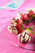 Strawberries with dark and white chocolate coating
