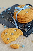Sable biscuits with blue chocolate beans and a gift ribbon