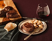 Wagyu Steak and White Beans on a Metal Plate; With Bread and Red Wine
