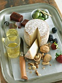 Artisanal Cheese with White Wine, Walnuts, Berries and Olives