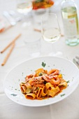 Pasta calamarata (pasta with prawns, tomato sauce and courgette)