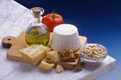 Italian still life with Grana Padano, ricotta and olive oil