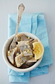 Pickled herring with garlic, lemon and marjoram