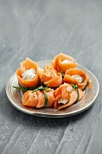 Rolls of smoked salmon filled with cream cheese with herbs