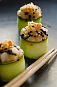 Scallop and sesame seeds rolled in strips of courgette (Asia)