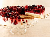 Cheesecake with berries, a piece removed