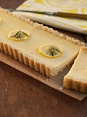 Rectangular Lemon Tart with Rosemary; Sliced on a Platter