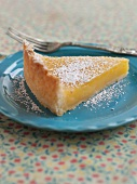 A Slice of Lemon Tart with Powdered Sugar