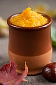 Pumpkin purée in a small clay pot