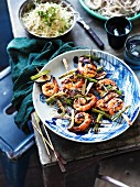 Barbecued prawn skewers with cabbage and daikon salad