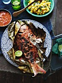 Barbecued snapper in a banana leaf with sambal belacan