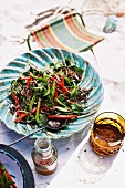 Herb salad with whole chillies for a tropical Christmas picnic