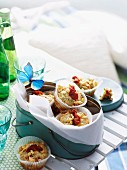 Courgette muffins with dried tomatoes and feta