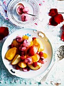 Fruit with rose syrup and ice cubes