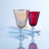 Two coloured cut-glass wine goblets