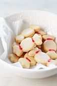 Sweetie-shaped biscuits in a white dish with a flower design