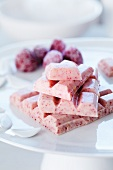 Raspberry chocolate with sugared raspberries in the background