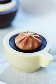 A chocolate in the shape of a coffee cup