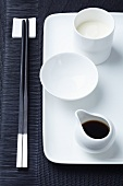 Asian tableware with soy sauce and Japanese mayonnaise