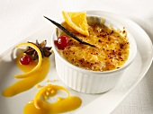 Crème brulée with orange, redcurrants and star anise