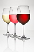 Three wine glasses (of white, rosé, and red wine)