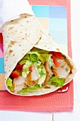 Chicken, salad and tomato wrap