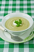 Celery soup with crème fraîche and parsley