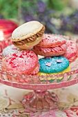 Macaroons filled with buttercream on a cake stand