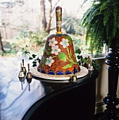 Wedding Bell Cake on a Platter Surrounded by Wedding Bells