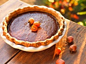 A Whole Persimmon Pie on a Wooden Table