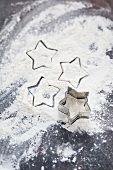 Star-shaped outlines and a star-shaped cutter on a floured work surface