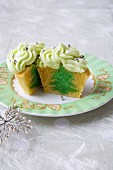 Vanilla Cupcake with a Green Tree Center and Green Frosting with Decorative Silver Balls; Halved