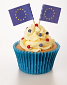 A cupcake decorated with buttercream and EU flags