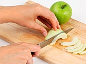 A green apple being sliced
