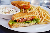 BLT sandwich with skinny fries and coleslaw