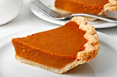 Two slices of pumpkin pie