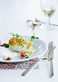 Fish with a crispy topping, radishes and watercress