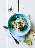 Sprout salad with cheese and coriander leaves, with a lime and some white bread