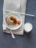 Glazed Mini Pumpkin Bundt Cake with a Glass of Milk; From Above