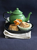 Mini Glazed Pumpkin Bundt Cakes with a Green Tea Pot