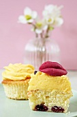 A cupcake topped with set custard and marzipan lips