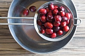 Freshly washed cranberries in a sieve