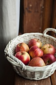 Pink Lady apples in a white basket